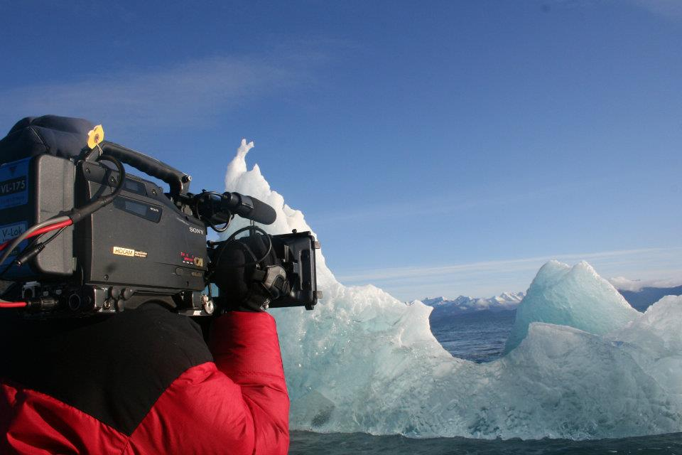 A cameraman films footage in Alaska for a Weather Channel documentary.